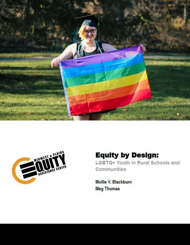 Graduating student with a rainbow flag