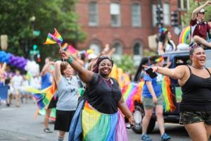 black teen woman at a pride parade